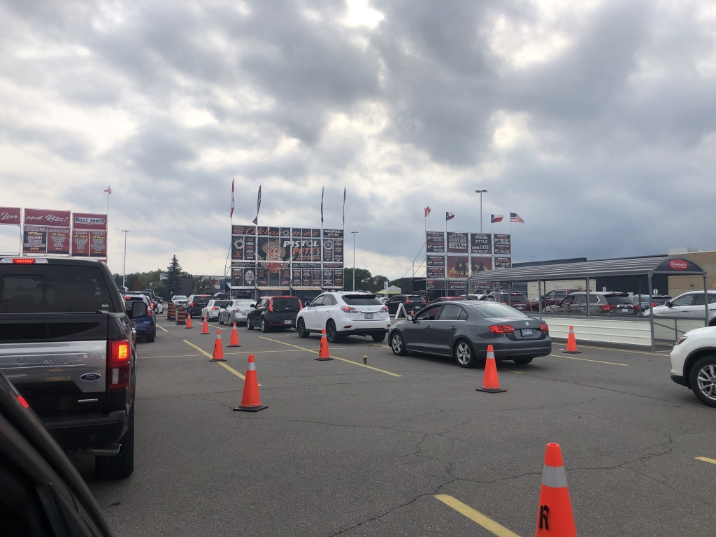 A line of cars preparing for the drive thru ribfest